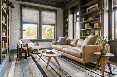 gray and white patterned living room wallpaper idea with leather sofa