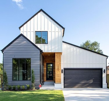white and gray exterior with black garage door