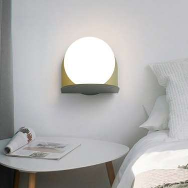 Milky Glass Orb bedroom wall sconce by Beautiful Halo