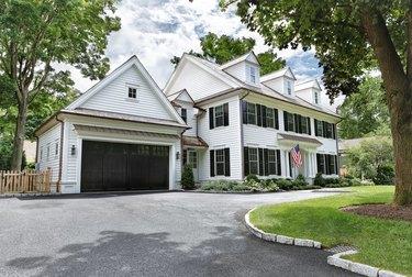 white house exterior with black garage door
