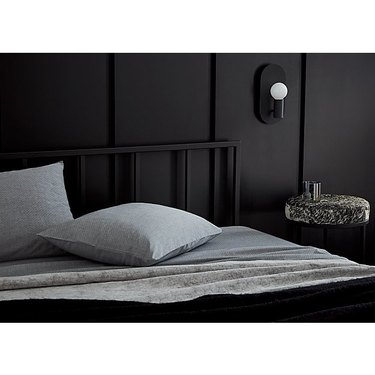 Plate Matte Black bedroom wall sconce from CB2