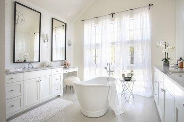 White home showcase interior bathroom with soaking tub