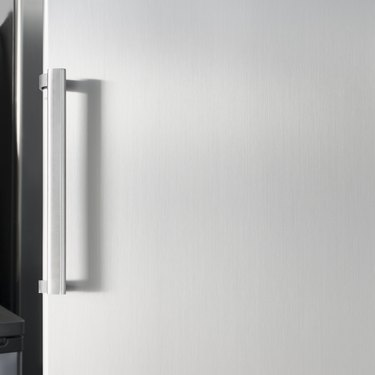 Silver fridge door with handle, with free space for text