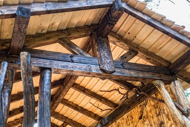Wooden roof beam. timber frame construction.