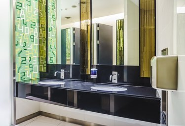 New modern restroom with touch-free automatic sensor faucets.