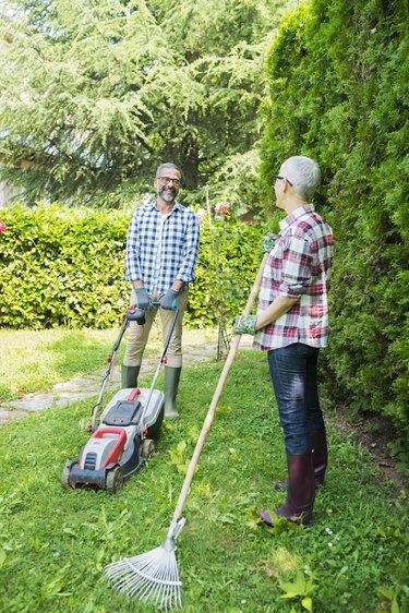 mowing and raking lawn