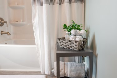 Clean modern bathroom decorated in gray and whir