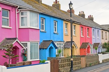A section of colorful terraced housing in a west country seaside town, UK