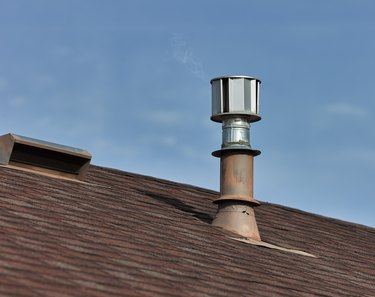 Metal roof vents on a composite shingled roof.
