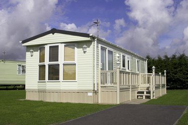 Stationary Mobile home with vinyl skirting.
