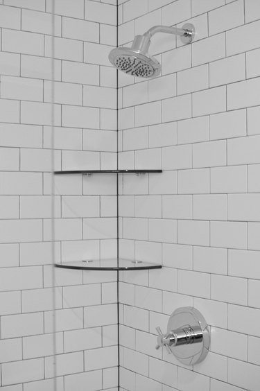 White Subway Tiles with Shelves in Shower