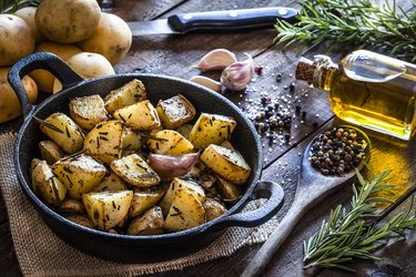 Roasted potatoes on wooden kitchen table