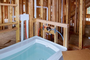 Bathroom unfinishing new home installation of plumbing, faucets, water and sewerage.