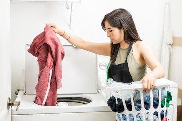 Loading a washing machine.