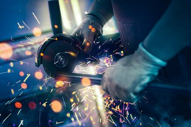 Sparks during cutting of metal part industrial grinder