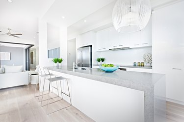 Luxury kitchen chairs and hanging lights with white walls