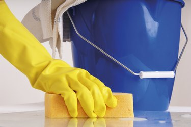 Person cleaning with sponge
