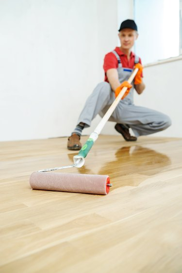 Lacquering wood floors.