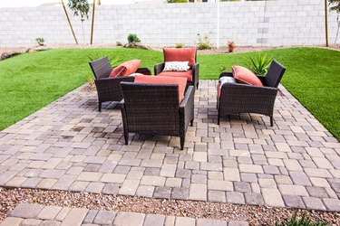 Outdoor Pavers Patio With Four Wicker Chairs