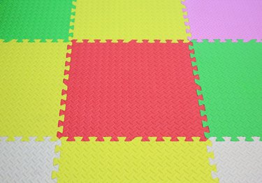 Colorful foam baby playground mat for kid. Soft mat rubber jigsaw background.
