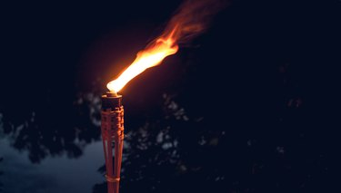 Holiday outdoor. Burning torch
