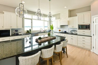 Modern Kitchen design with open concept and bar counter Kitchen Island