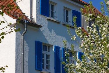 House facade, white and blue.