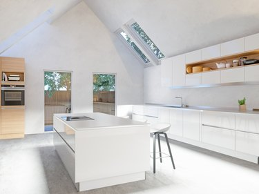 Large, uniform white marble tiles create a seamless space