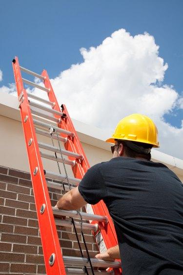 Construction Worker Climbs Ladder