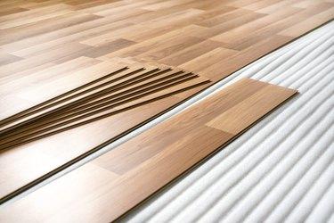 Laminated flooring tiles