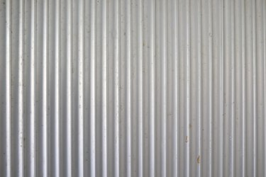 Old Background texture Aluminum metallic corrugated fence