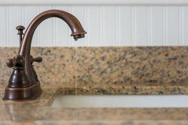 Bronze bathroom vanity faucet and sink