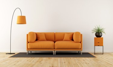 Cushions On Sofa At Home Against Wall