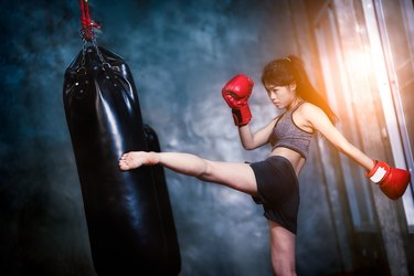 Young Woman Practicing Boxing In Gym
