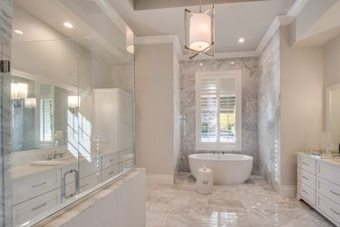 Luxurious all white marble and wood bathroom