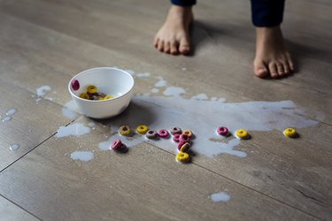 Spilled bowl of milk and cereal