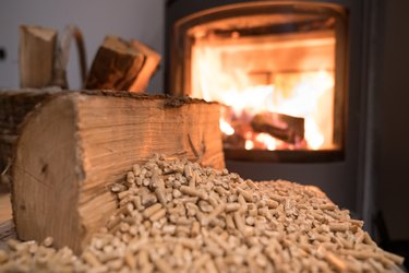 Wood stove heating with in foreground wood pellets