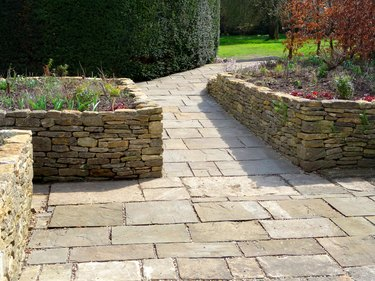 Image of raised garden beds with flagstone paving patio, wheelchair-friendly