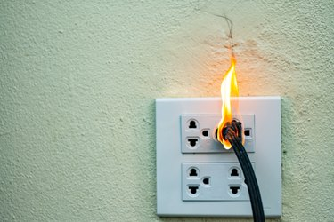 On fire electric wire plug.