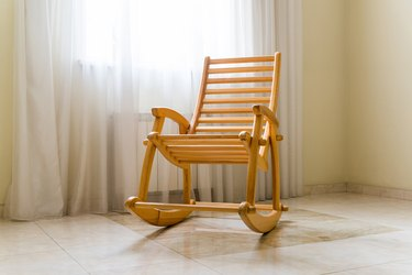 Wooden rocking chair near the window in room