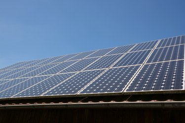Solar panel on roof and sky background.