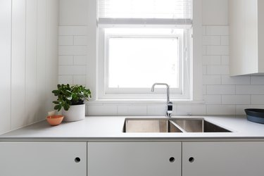 Close up details of contemporary white apartment kitchen