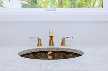 Close up of sinks in modern bathroom white stone