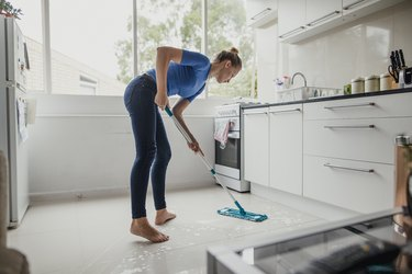 Young Female Cleaning Floor