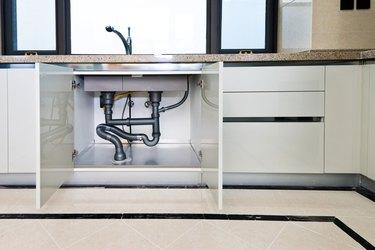 Water pipe under kitchen sink