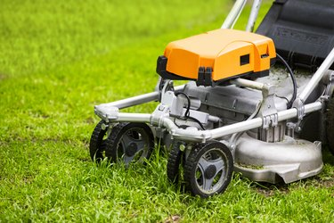 Lawn mower on a fresh lawn in the garden