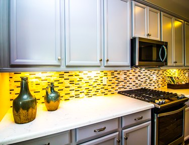 Kitchen With Decorative Jugs And Back Splash