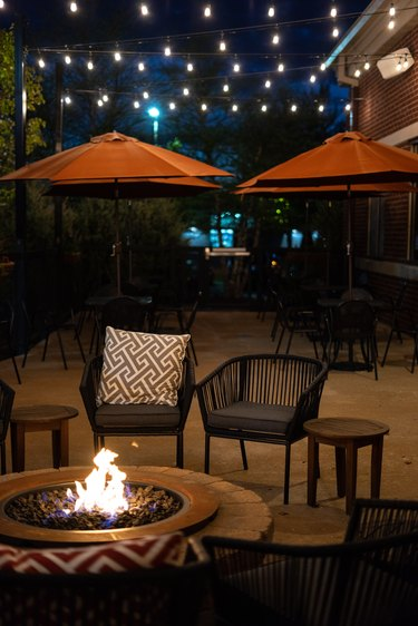 Outdoor patio with lights and a fire pit
