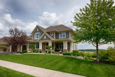 Suburban house with expansive lawn.