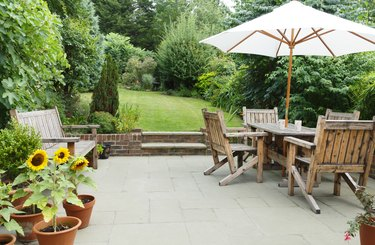 Patio with garden furniture and parasol